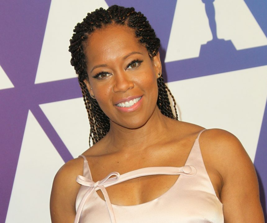 Embiid's leap into seats narrowly misses actress Regina King