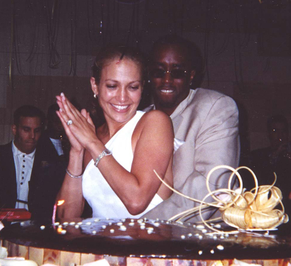 Jennifer Lopez and Sean Combs at her surprise birthday party in 2000