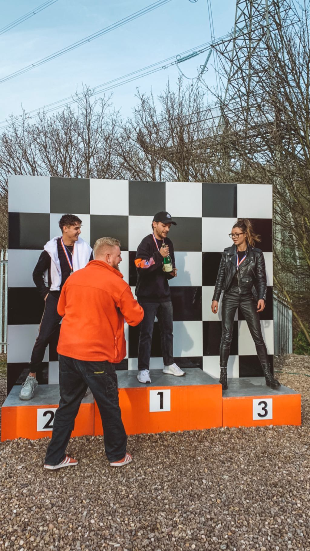 louis tomlinson is crowned the winner while gokarting