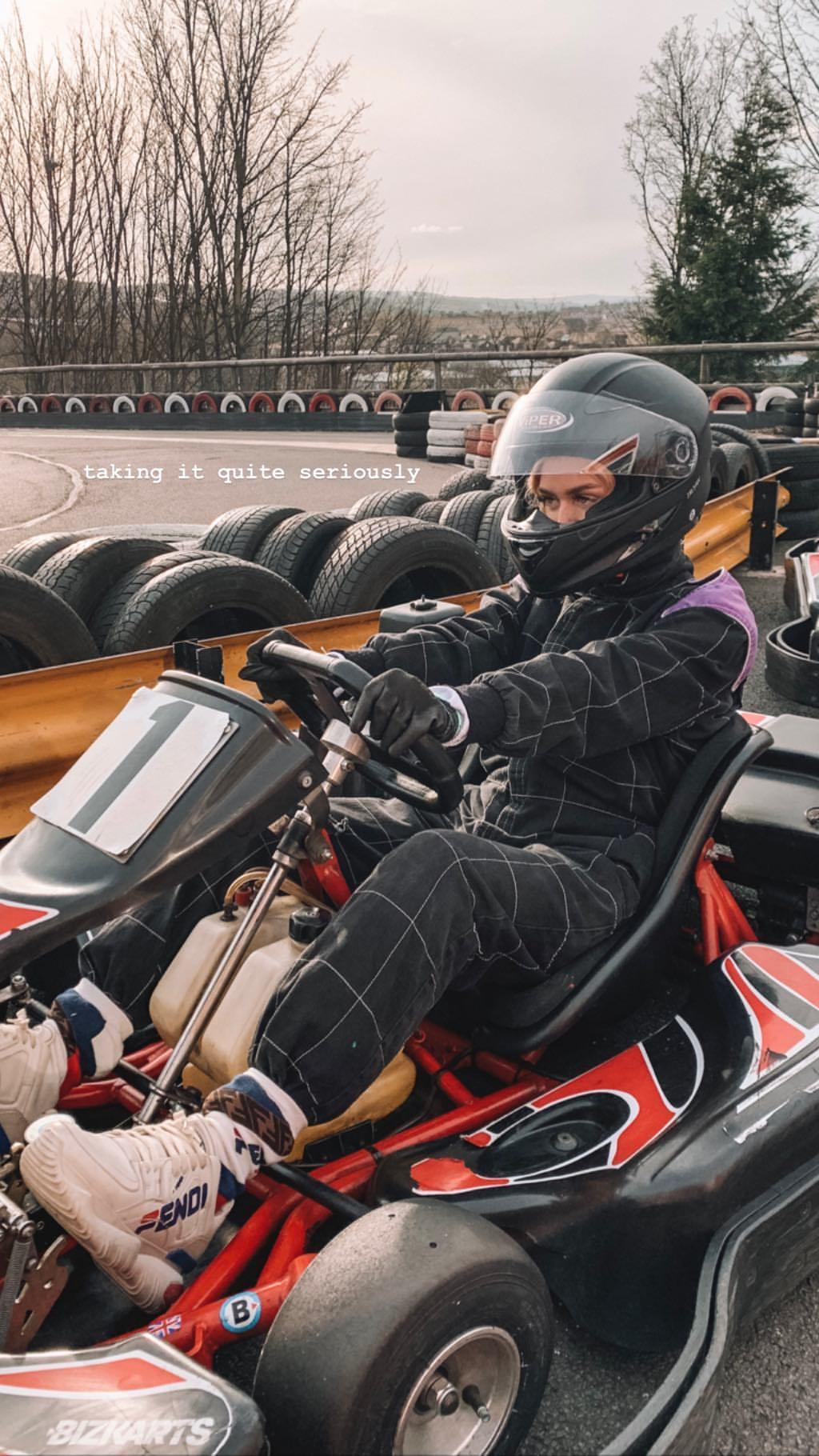 Lottie tomlinson poses on the go kart