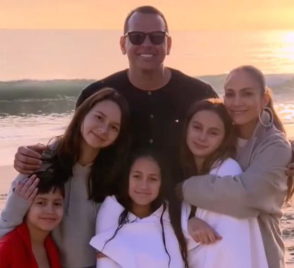 Jennifer Lopez and Alex Rodriguez posing with their kids.