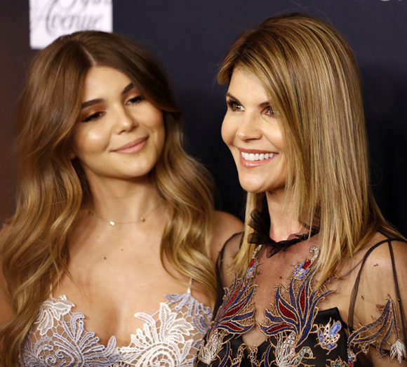 Olivia Jade and Lori Loughlin are leaning on each other