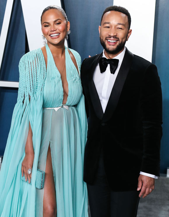 Chrissy Teigen and John Legend actively support each other's goals.