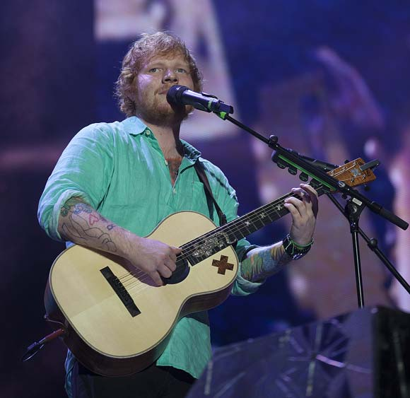 Ed Sheeran opens up about binge eating and drinking during his 2015 world tour.