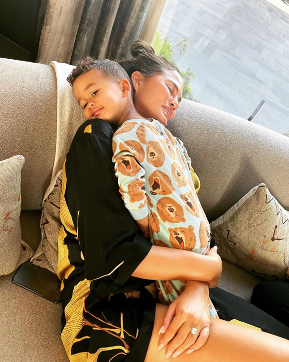 Chrissy Teigen enjoying a hug from her son Miles.