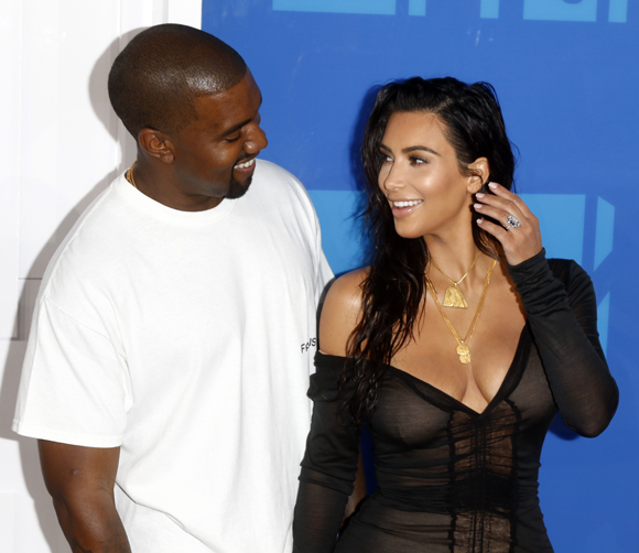Kim Kardashian defends Kanye West's frequent and frivolous use of private planes.