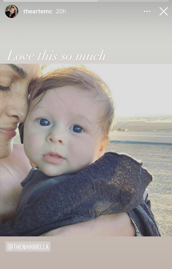 Artem Chigvintsev shares a photo of Nikki Bella holding their son Matteo on her birthday.